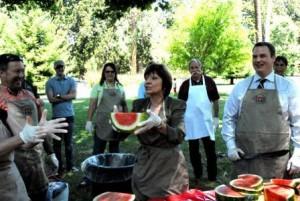 CDFA Secretary Karen Ross slicing watermelon