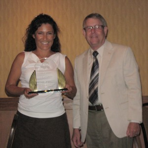 Photo of Tina Galindo receiving the President's Award from Citrus Research Board President Ted Batkin.