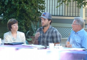 Image of young farmer speaking at event; links to YouTube video.