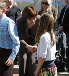 CDFA Secretary Karen Ross congratulates Grace Reyes at the annual Ag Day event on the Capitol steps in Sacramento.