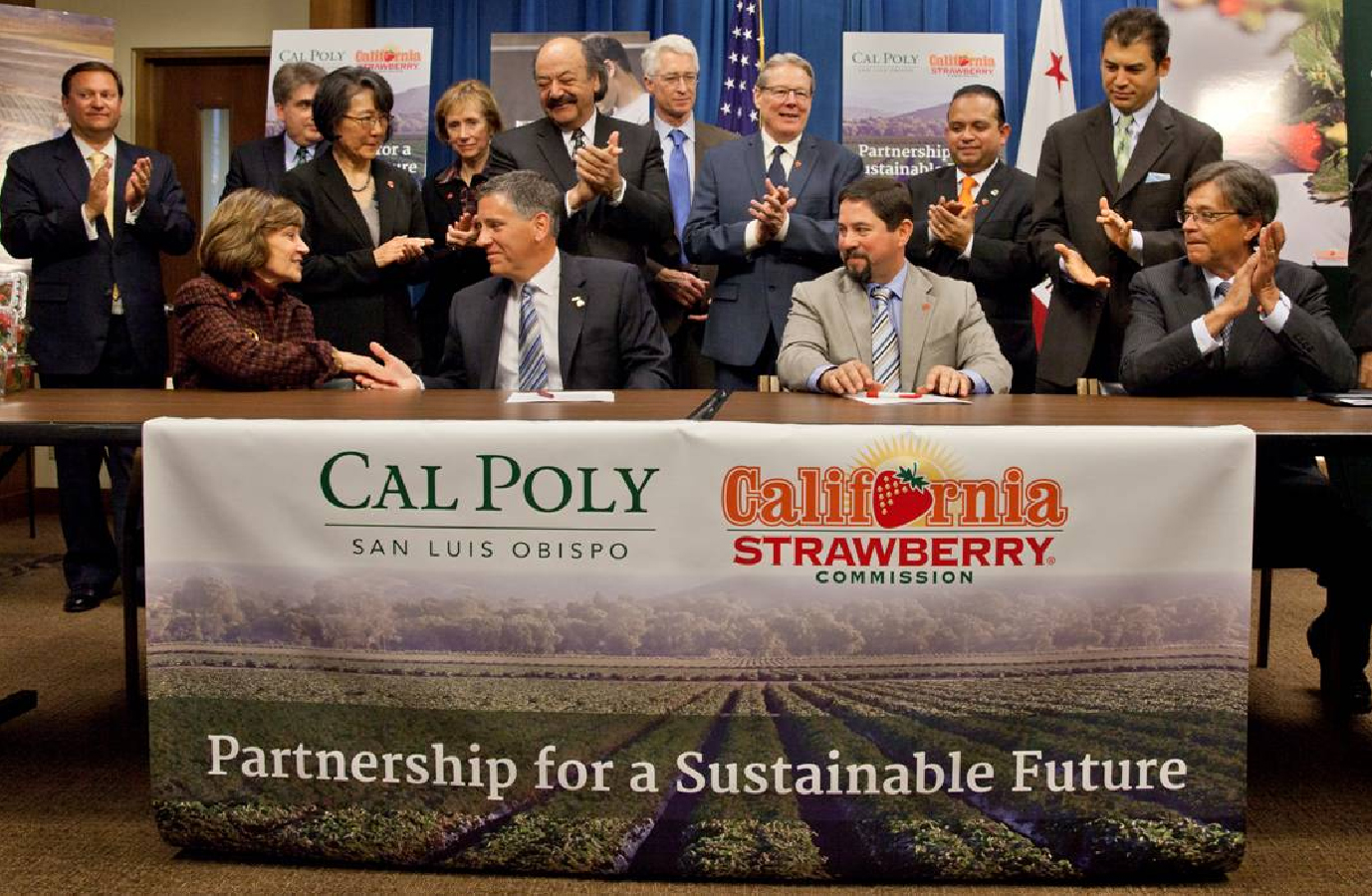 CDFA secretary Karen Ross, seated far left, congratulates Cal Poly, San Luis Obispo president Jeffrey Armstrong at the signing ofa partnership agreement with California Strawberry Commission president Victor Ramirez, seated second from right. Seated at the far right is is Cal-EPA secretary Matt Rodriquez.