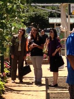 "Secretary Ross (L) visits the urban farming exhibit at the California State Fair along with Nancy Koch, manager of ""The Farm,"" and CDFA Undersecretary Sandra Schubert (R)."