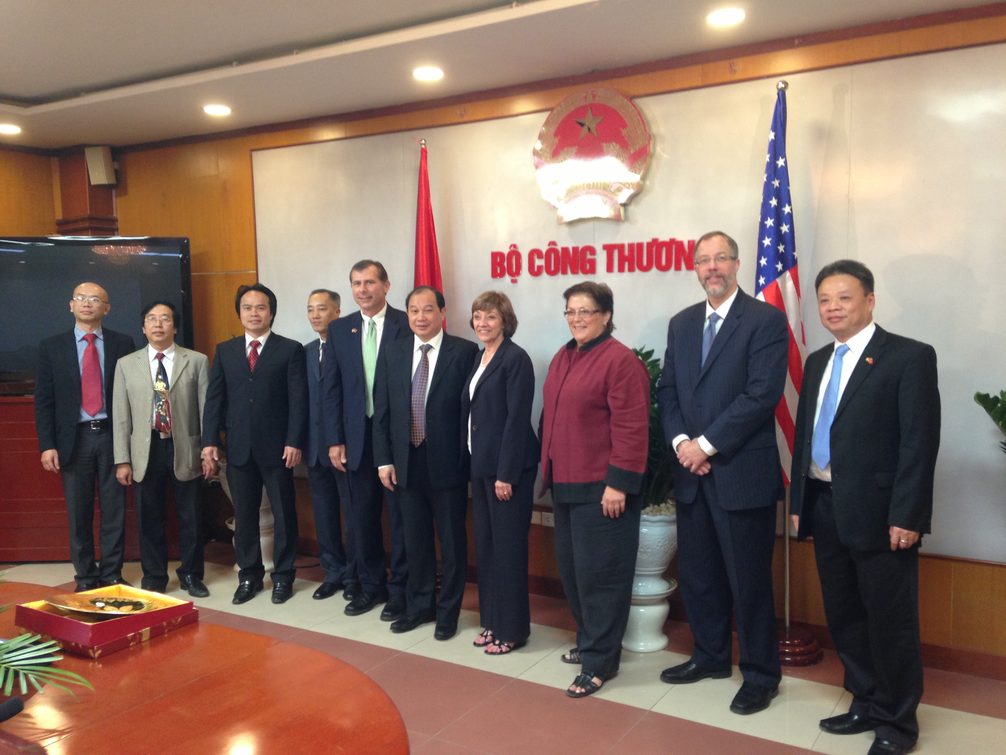 CDFA Secretary Karen Ross (fourth from right) at a trade meeting in Vietnam. Richard Matoian of the American Pistachio Growers is two spots to her right.