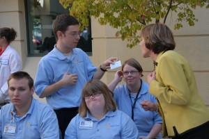 CDFA Secretary Karen Ross asks Project Search student Alex White about his internship at a local Kaiser facility. Also pictured are Project Search students (from left) Jeff Bower, Megan Harris and Loretta Dobbins.