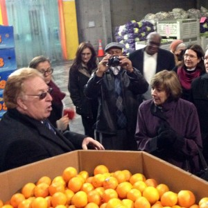 California Emergency Foodlink President/CEO John Healey discusses California-grown citrus donations with CDFA Secretary Karen Ross and others during a tour of the Foodlink facility.