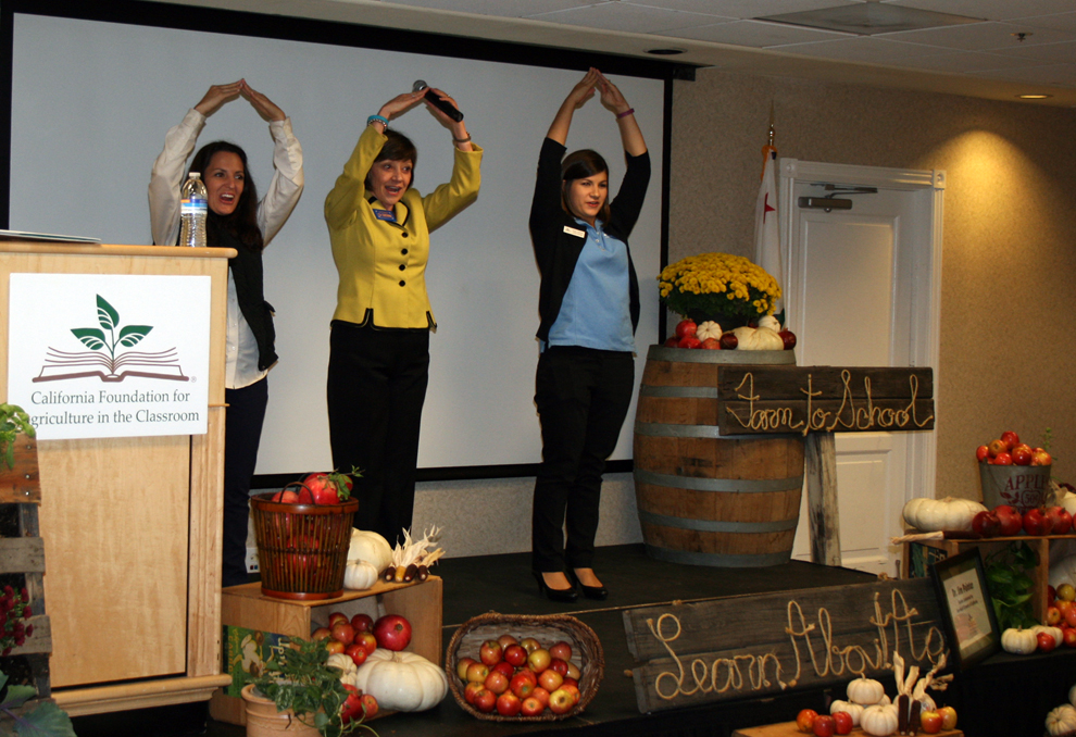 CDFA Secretary Karen Ross (center) demonstrates the five F's of agriculture--Food,  Fiber, Flower, Forests and Fuel--at a California Foundation for Agriculture in the Classroom event this month in Santa Cruz. The picture depicts forestry, showing that it helps provide housing.