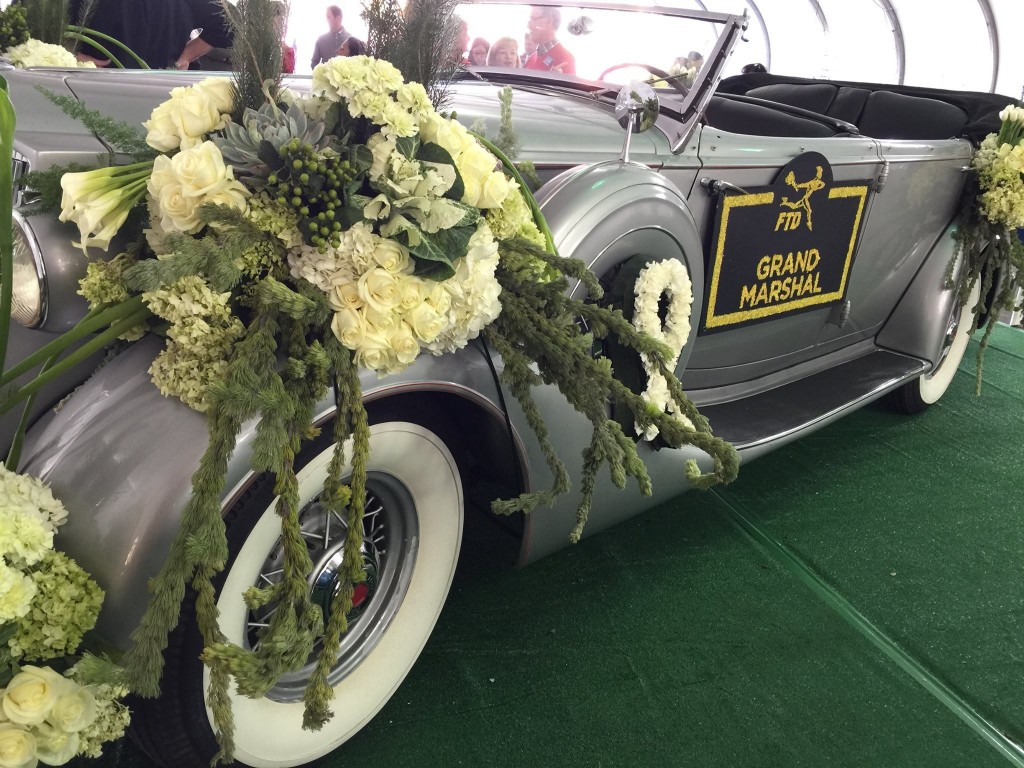 The newly released movie Unbroken tells the story of Louis Zamperini, this year's Rose Parade Grand Marshal, who unfortunately passed away in July. FTD Flowers honored him by adorning a 1936 Packard Standard Eight with delicate flower varieties alongside Olympic rings to celebrate Zamperini's medal in the 1936 Berlin Games and a ribbon in tribute to his military service.