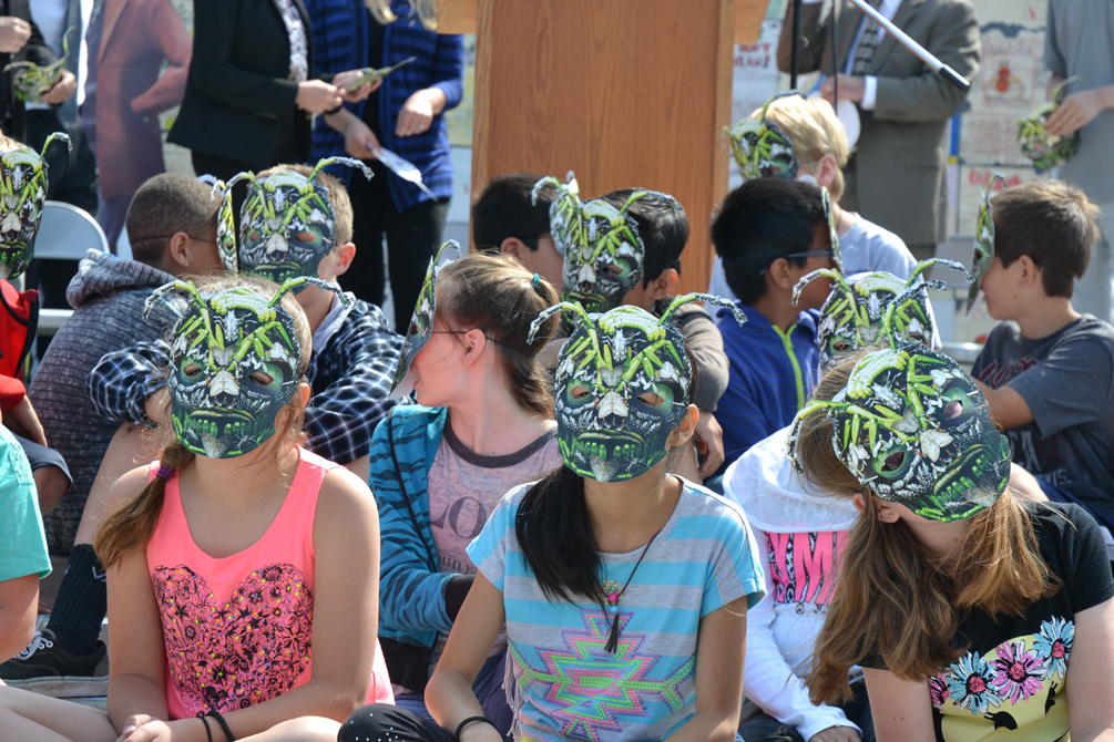 """Sixth-graders from Cowan Fundamental Elementary School don """"Vin Vasive"""" masks as part of the Hungry Pests project. Look closely to see the many invasive pests that make up Vin Vasive's face..."""