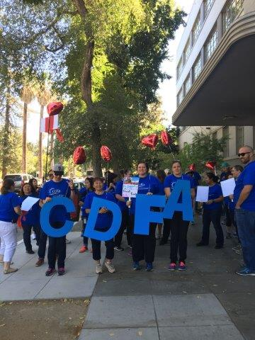 Employees holding CDFA letters for Heart Walk