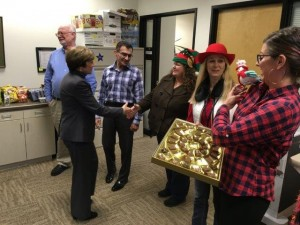 Employees of the Division of Animal Health and Food Safety Services offer some holiday cheer.