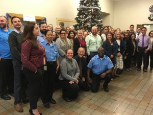 Employees of CDFA's Office of Administrative Services in front of the holiday tree on the first floor of the CDFA headquarters building.
