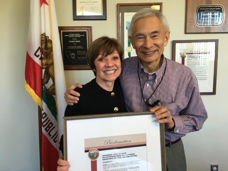 CDFA Secretary Karen presents Milk Pooling Branch Chief John Lee with a congratulatory proclamation of his upcoming retirement. Lee's last day will be December 30 - capping a 42-year career in state service.