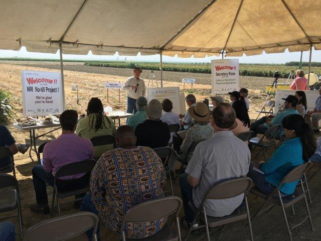 A speaker addresses attendees