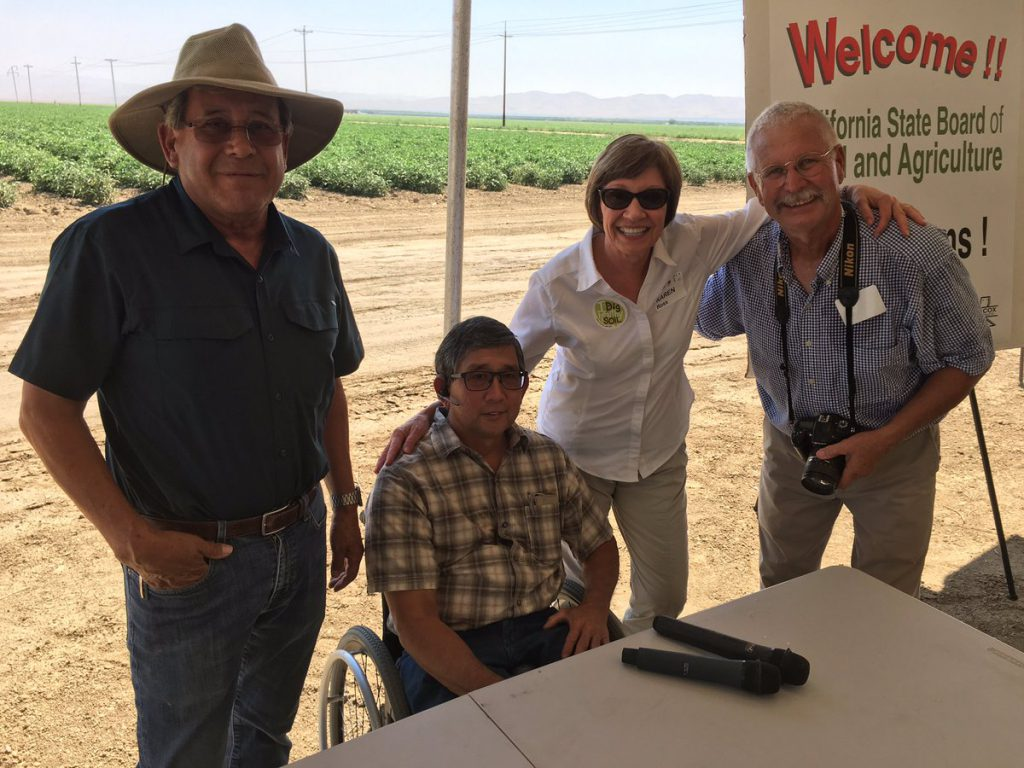 Secretary Ross poses with farmers