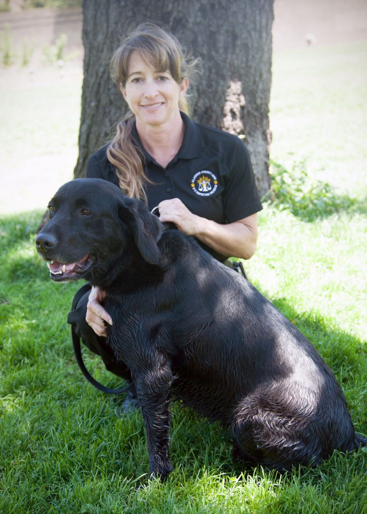 "Alameda County parcel inspection dog ""Cosmo"" and handler Lisa Sampson"