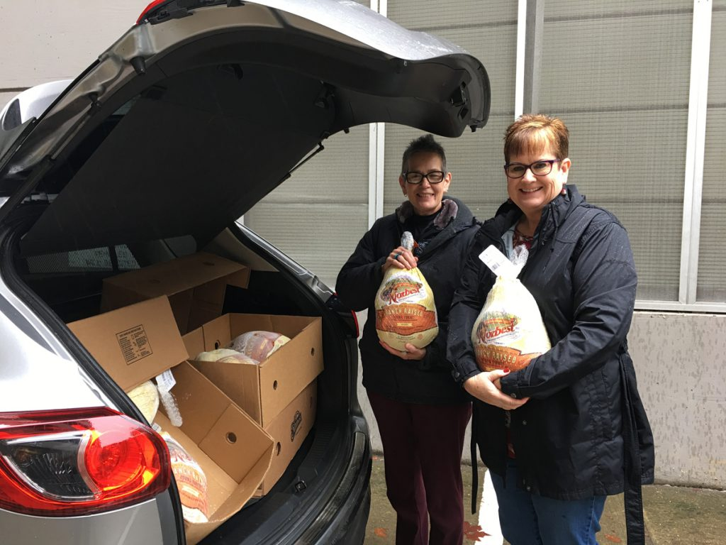 CDFA Headquarters employees Michelle Lehn and Thea Lee load donated turkeys for delivery to the food bank