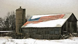 A barn with an American flag on the roof