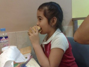 A child eating a hamburger
