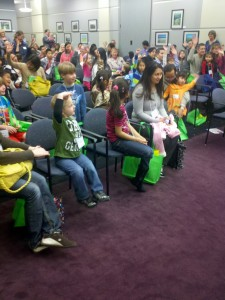 Children visiting CDFA on Ag Day raise their hands when asked if they like broccoli.