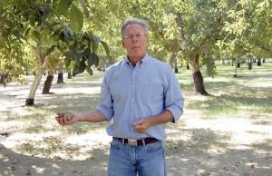 Craig McNamara in an orchard