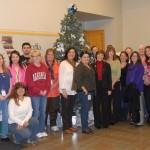 CDFA employees pose with the lobby holiday tree