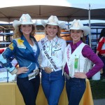 Three rodeo champions posing at Ag Day