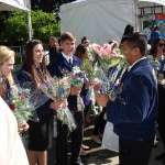 FFA members handing out flowers at Ag Day