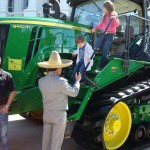 Kids climbing off a large tractor at Ag Day