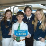 FFA students pose with a CA GROWN license plate