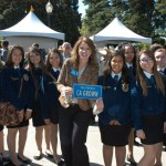 FFA students posing with a CA GROWN license plate
