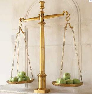 A scale weighs apples