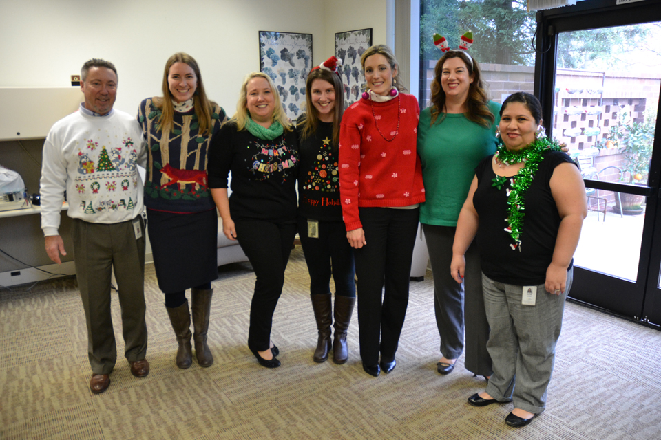 Holiday sweaters all around at Inspection Services – and antlers, and earrings