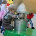 Milking Buttercup the electronic cow, part of the California Women for Agriculture booth