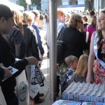 Attendees visit a milk booth at Ag Day