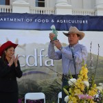 Board of Equalization member Fiona Ma presents an award to Tim Thornhill of Parducci Wine Cellars