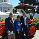 Secretary Ross with Michael O'Gorman of the Farmer Veteran Coalition and Todd Stucke with Kubota Tractor Company - California