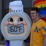 Mark Canha of the Oakland A's poses with food safety mascot Thermy