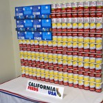 """An American flag made of soup cans and boxes of macaroni cheese, entitled """"California Feeds the USA"""""""