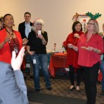 Division of Marketing Services employees singing
