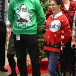 Inspection Services staff show of their holiday sweaters
