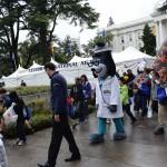 A healthcare mascot entertains children