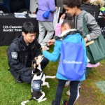 Myers, a detector dog, greets Ag Day attendees