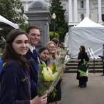 FFA members hand out flowers at the California State Floral Association booth