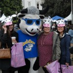 """The """"Cool Cow"""" mascot poses for photos at Ag Day"""