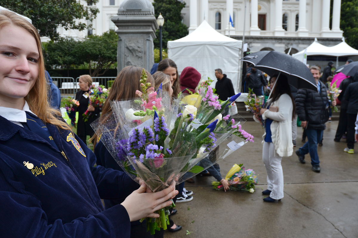 An FFA member holds a bouquet of flowers