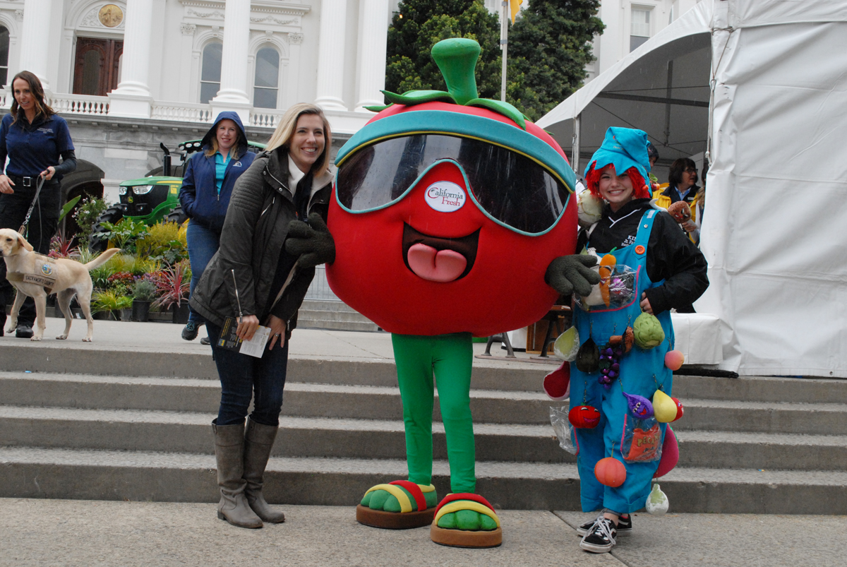 The California Fresh mascot posing for photos