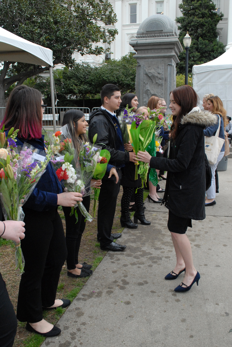 Ag Day attendees holding bouquets of flowers