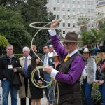 Assemblymember Matthew Harper swinging a lasso over his head