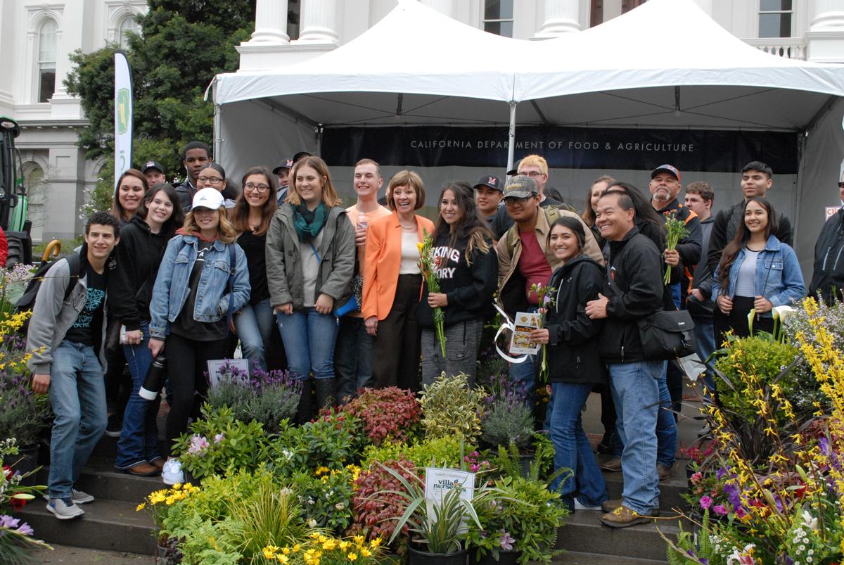 CDFA Secretary Karen Ross posing with FFA members
