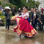 Charros dancing and lassoing in the rain